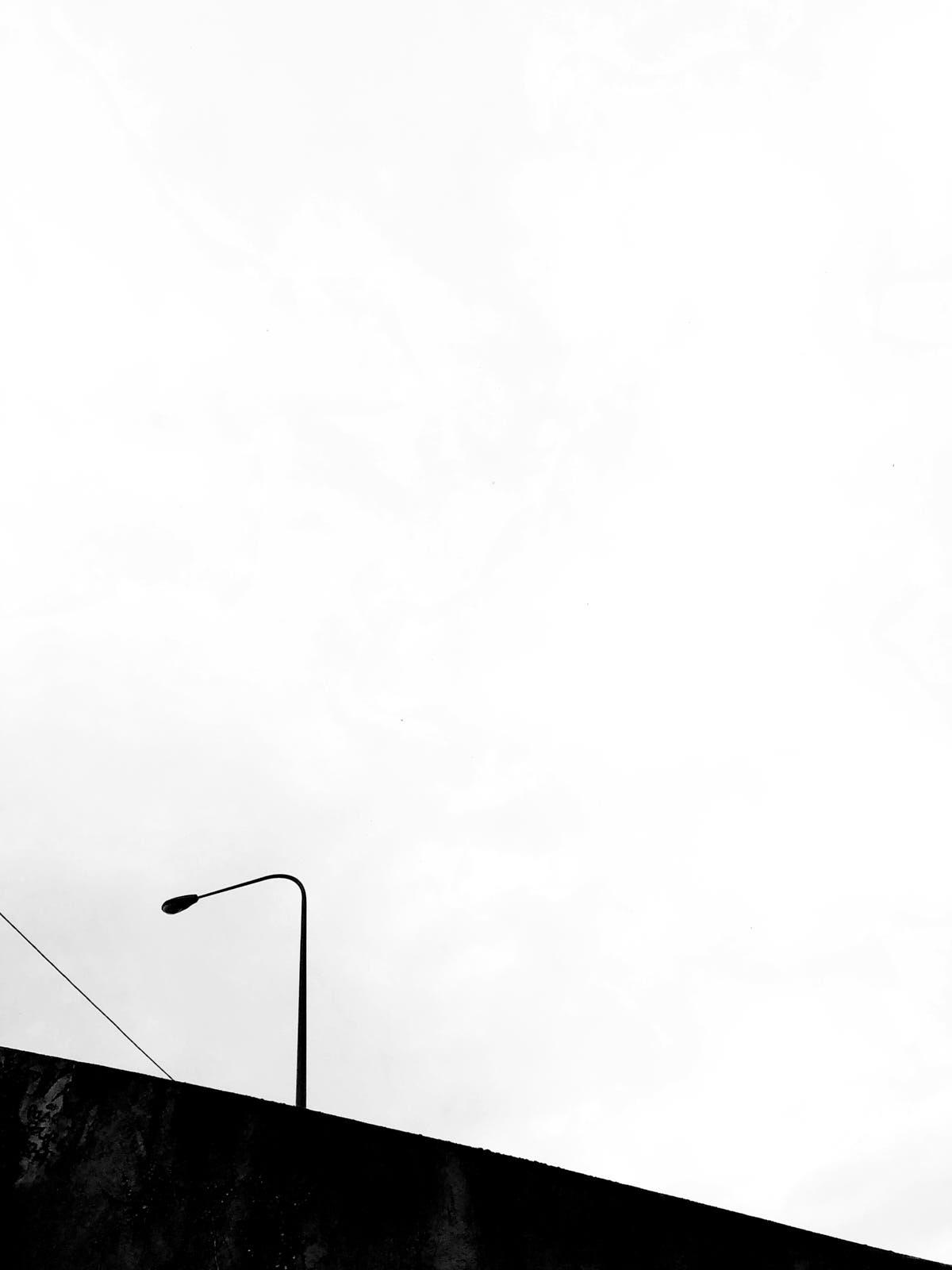 minimalist photography of a street lamp